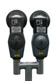 Isolated Twin Parking Meters. A Pair of old fashioned Parking Meters, Isolated with Clipping Paths Stock Images