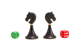 Isolated two chess black knightes and dices Royalty Free Stock Images