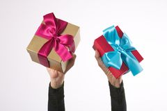 Isolated two gifts in woman arms Stock Photography