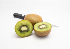 Isolated Two Kiwis and knife. Two Kiwis fruits and knife with white background royalty free stock photo