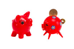 Isolated two red piggy-banks Royalty Free Stock Image