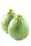Isolated round courgette on white Stock Photos