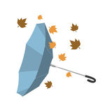 Isolated umbrella invested with autumn leaves Royalty Free Stock Image