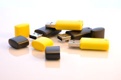 Isolated usb memory sticks. Black and yellow usb flash disks, open and ready for use Royalty Free Stock Photo
