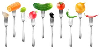 Isolated vegetables on forks Stock Images