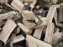 Isolated view on chopped wood. Piled in an unsorted way, looking quite chaotic. Ready to be set on fire.  stock image