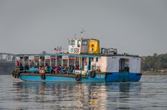 An isolated view of a ferry crossing river Ganges stock image