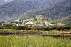 The isolated village of Bario. With rice fields surrounded by mountains and rainforest. Bario, Malaysia, Borneo, Sarawak stock photography