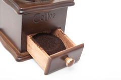 Isolated vintage coffee bean grinder and fresh ground coffee. Next to coffee bean Stock Image
