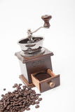 Isolated vintage coffee bean grinder and fresh ground coffee. Next to coffee bean Stock Photo