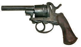 Isolated vintage firearm revolver. Isolated rusty obsolete vintage firearm revolver white background Royalty Free Stock Photos