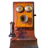 Isolated Vintage Telephone. A wooden vintage telephone isolated on white Stock Photography