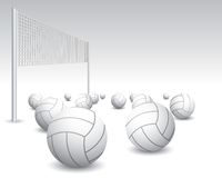 Isolated volleyballs and net. Isolated and scattered volleyballs and net Royalty Free Stock Photography