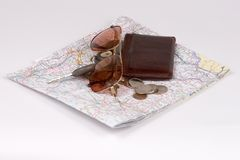 Isolated Wallet, Coins, Keys, Glasses on Map. Isolated View of a Pile of Coins, Keys, Wallet, Glasses on a Road Map Royalty Free Stock Photography