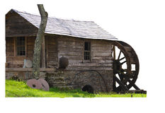 Isolated water mill. A water mill isolated leaving the green grass and the tree royalty free stock photos