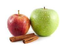 Isolated wet green and red apple with cinnamon Stock Photos