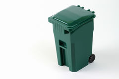 Isolated wheeled green trash can Stock Photos