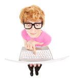 Funny nerdy guy with a laptop computer royalty free stock photo