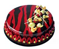 Red and black chocolate raspberry and pistachio cake with berries and chocolate decoration royalty free stock image