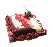 Red and white chocolate cake with cranberries and chocolate decoration stock photo