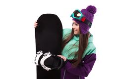 Young beautiful woman in purple ski coat and goggles hold snowbo. Isolated on white, brunette beauty young caucasian girl in purple ski suit and blue ski glasses Royalty Free Stock Image