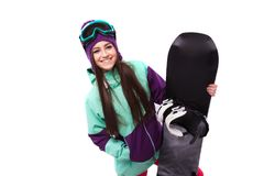Young beautiful woman in purple ski coat and goggles hold snowbo. Isolated on white, brunette beauty young caucasian girl in purple ski suit and blue ski glasses Royalty Free Stock Photo