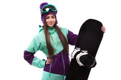 Young beautiful woman in purple ski coat and goggles hold snowbo. Isolated on white, brunette beauty young caucasian girl in purple ski suit and blue ski glasses Stock Images