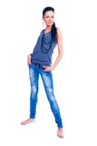 Isolated on white brunette woman standing in jeans Royalty Free Stock Photography