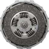 Isolated on white car truck clutch. Close up front view of new composite clutch disc inside open housing for trucks and tractors Royalty Free Stock Photography