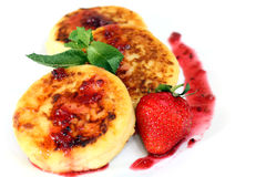 Isolated on white cheese pancakes with strawberry stock images