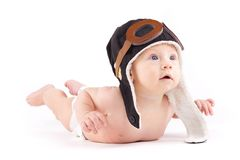 Cutie little boy in white diaper and pilot hat. Isolated on white, cute amazed caucasian baby boy in white diaper and pilot hat, lies on belly, look at right Royalty Free Stock Photos