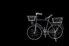 Isolated white decoreted bicycle on black Stock Image