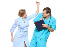 Isolated on white. doctor swears nurse. He screams and beats him. A medical team of doctors, men and woman, isolated on white background royalty free stock photography