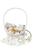 Isolated white and gold gift boxs in basket Royalty Free Stock Images