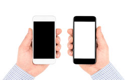 Isolated on white hands holding smartphones with blank screen. Stock Photography