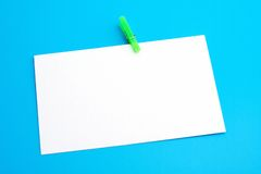 Isolated white paper with green clamp Stock Image