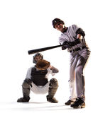 Isolated on white professional baseball players. In action stock photography