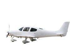 Isolated white prop plane. White light aeroplane isolated on a white background Royalty Free Stock Photography