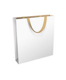 Isolated white shopping bag with golden handle Stock Photography