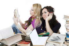 Isolated on white two girls with books Royalty Free Stock Images