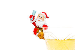 Isolated white wine glass and Santa Claus. Royalty Free Stock Photo
