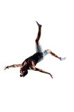 Isolated white young man is jumping on trampoline Royalty Free Stock Photography