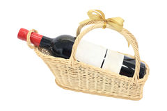 Isolated wine bottle with blank label on basket Royalty Free Stock Image