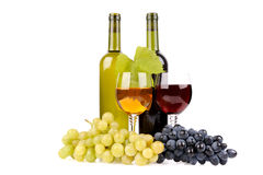 Isolated wine bottle with glass and green grapes Royalty Free Stock Image