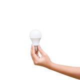Isolated of woman hand holding LED bulb on white background Royalty Free Stock Photo