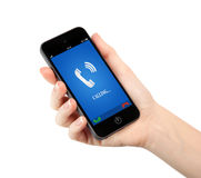 Isolated woman hand holding phone with blue screen and the phone. Isolated woman hand holding a touch phone with blue screen and the phone ringing tube Royalty Free Stock Photography