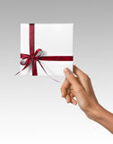 Isolated Woman Hands holding Holiday Present White Box with Red Ribbon on a White Background Royalty Free Stock Photos