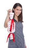 Isolated woman holding a present with red hearts. Royalty Free Stock Image