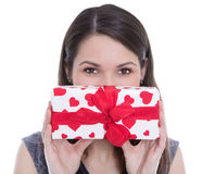 Isolated woman holding a present with red hearts. Stock Photo