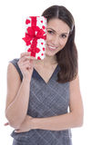 Isolated woman holding a present with red hearts. Royalty Free Stock Images